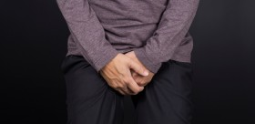 Man Covering His Crotch: Isolated Background