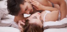 Man on top woman in bed