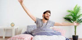 Happy man in bed